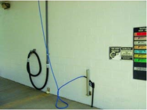 The vacuum hose is available to the customer inside the wash bay.
